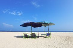 Comfort chairs and umbrella on the beach Royalty Free Stock Image