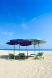 Comfort chairs and umbrella on the beach Stock Photography
