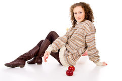 Comfort curly girl with apples sits Stock Images