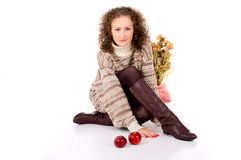 Comfort curly girl in a sweater and apples Stock Images