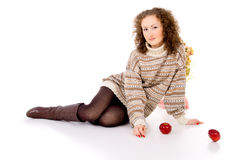 Comfort  girl with apples sits in a sweater Royalty Free Stock Photos