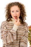 Comfort, the girl in a sweater eating chocolate candy Royalty Free Stock Photos