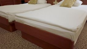 Comfort hotel twin bed room. Tilt up from corner of the room stock footage