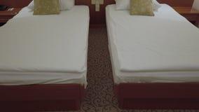 Comfort hotel twin bed room. Revealing tilt up stock footage