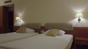 Comfort hotel twin bed room. Right to left pan stock video footage