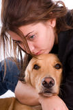 Comfort hug. Sad woman hugging her Golden Retriever dog for comfort royalty free stock photography