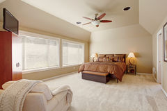 Comfort master bedroom interior with high vaulted ceiling Royalty Free Stock Image