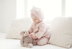 Comfort, sweet baby playing at home Stock Image