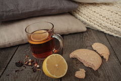 Comfort and tea with lemon and biscuits. Stock Photo