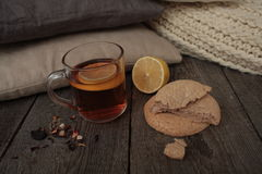 Comfort and tea with lemon and biscuits. Royalty Free Stock Photos