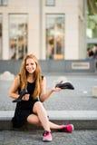 Comfort wins - sneakers versus high heels Royalty Free Stock Images
