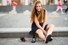 Comfort wins - sneakers versus high heels Stock Photography