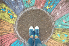 Comfort zone concept. Feet standing inside comfort zone circle. Comfort zone concept. Feet standing inside comfort zone circle surrounded by rainbow stripes Stock Images