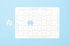 Comfort zone concept. One jigsaw out of the comfort zone to success. Pastel style Royalty Free Stock Image