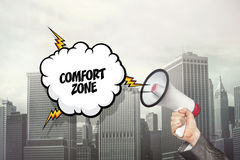 Comfort zone text on speech bubble and businessman hand holding megaphone Royalty Free Stock Image