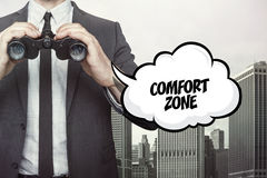 Comfort zone text on speech bubble with businessman holding binoculars Stock Images