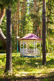 Comfortable arbour house in the park green forest. Comfortable arbour in the park green forest Stock Photo