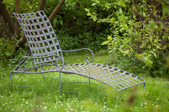 Comfortable armchair in the garden Stock Images