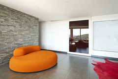 Comfortable armchair orange Stock Photography