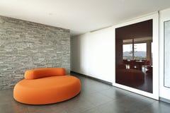 Comfortable armchair orange Royalty Free Stock Image