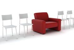Comfortable armchair between ordinary seats Stock Photos