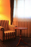 Comfortable armchair by the window Royalty Free Stock Image