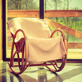 Comfortable armchair with window in background Stock Images