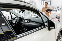 Comfortable automobile salon situating in showroom Royalty Free Stock Photo