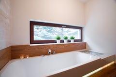 Comfortable bath in elegant bathroom Royalty Free Stock Photo