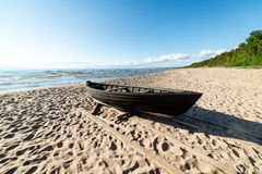 Comfortable beach of the baltic sea with boat Royalty Free Stock Photography