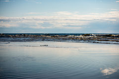 Comfortable beach of the baltic sea with wooden stick Royalty Free Stock Images