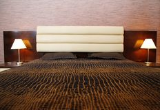 Comfortable bed. And two lamps Royalty Free Stock Photos