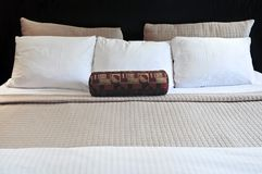 Comfortable bed. In upscale hotel close up Royalty Free Stock Photo