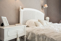 Comfortable bed in a bedroom Royalty Free Stock Image