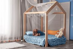 Comfortable bed in   children room. Comfortable bed in modern children room Stock Image