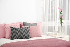 Comfortable bed with cushions. In room Stock Photo