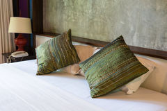 Comfortable bed with decorative cushions Stock Photo
