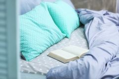 Comfortable bed with pillows. In bedroom Stock Images
