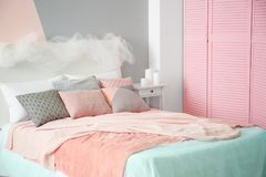 Comfortable bed with pillows. In room Royalty Free Stock Photo