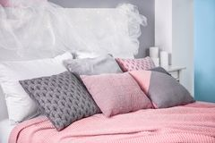 Comfortable bed with pillows. In room Royalty Free Stock Images