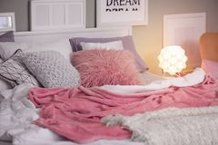 Comfortable bed with pillows. In room Stock Photos
