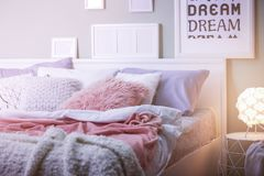 Comfortable bed with pillows. In room Royalty Free Stock Photography