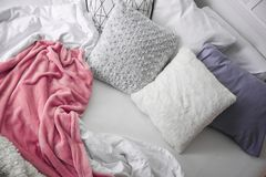 Comfortable bed with pillows. In room Stock Photo