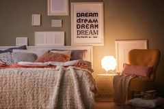 Comfortable bed with pillows. In room Stock Image