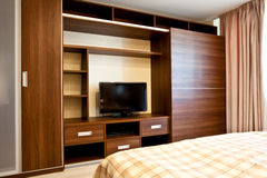 Comfortable bedroom. With TV and wardrobes Stock Photography