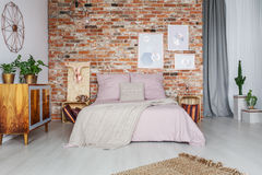 Comfortable big bed. In cozy stylish bedroom Stock Photo