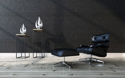Comfortable black leather recliner chair. With a matching footstool in a modern home interior with a wooden parquet floor, black wall and two contemporary Royalty Free Stock Photos