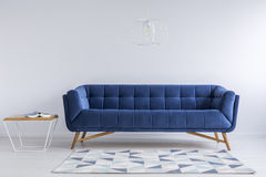 Comfortable blue couch Royalty Free Stock Images