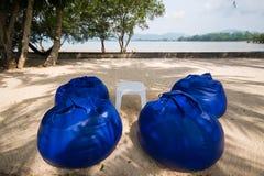 Comfortable blue seats near the sea Stock Photo