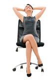 Comfortable business woman on a chair Stock Images